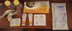 harmony manual breast pump with lots of